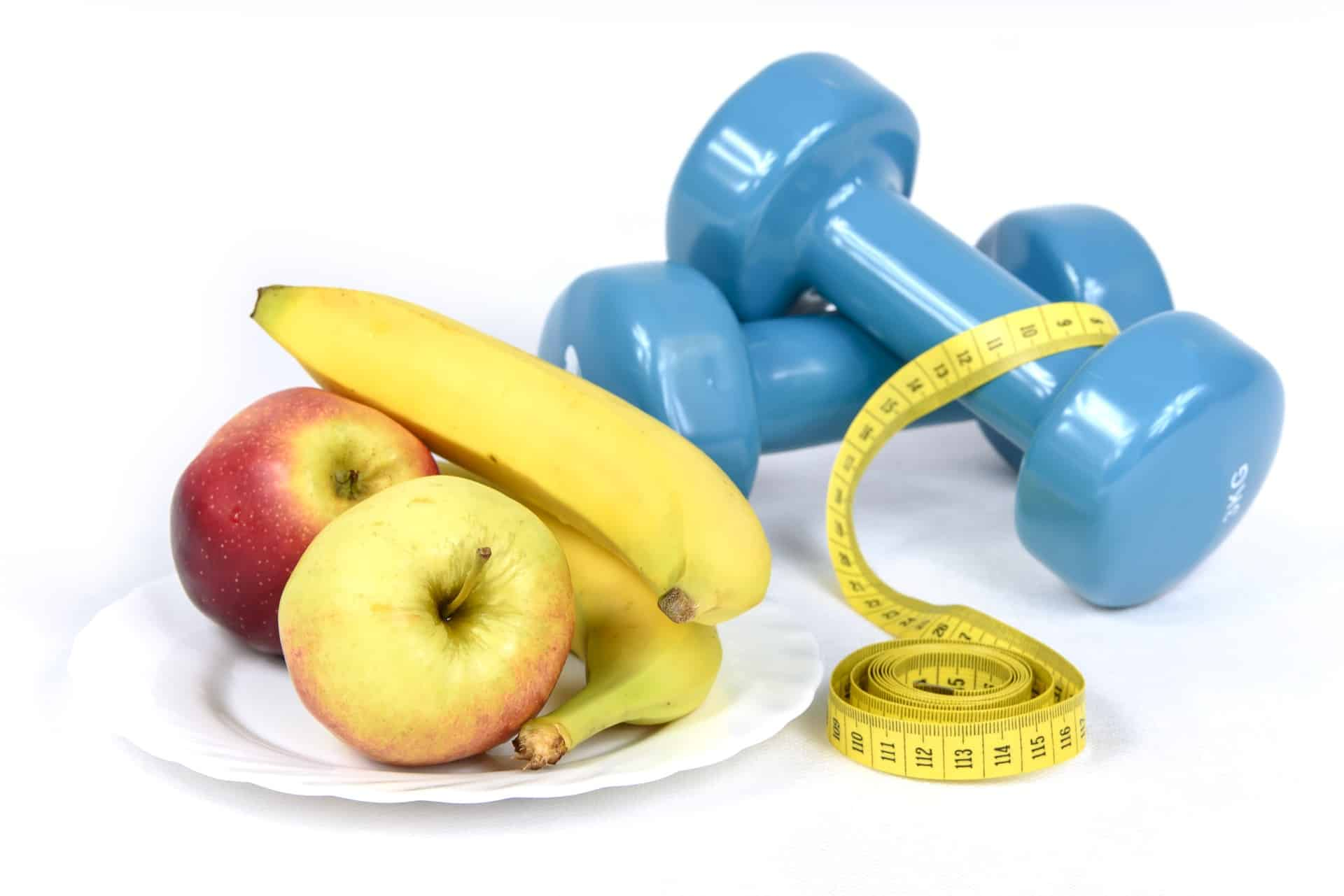 dumbbells and fruit on a plate