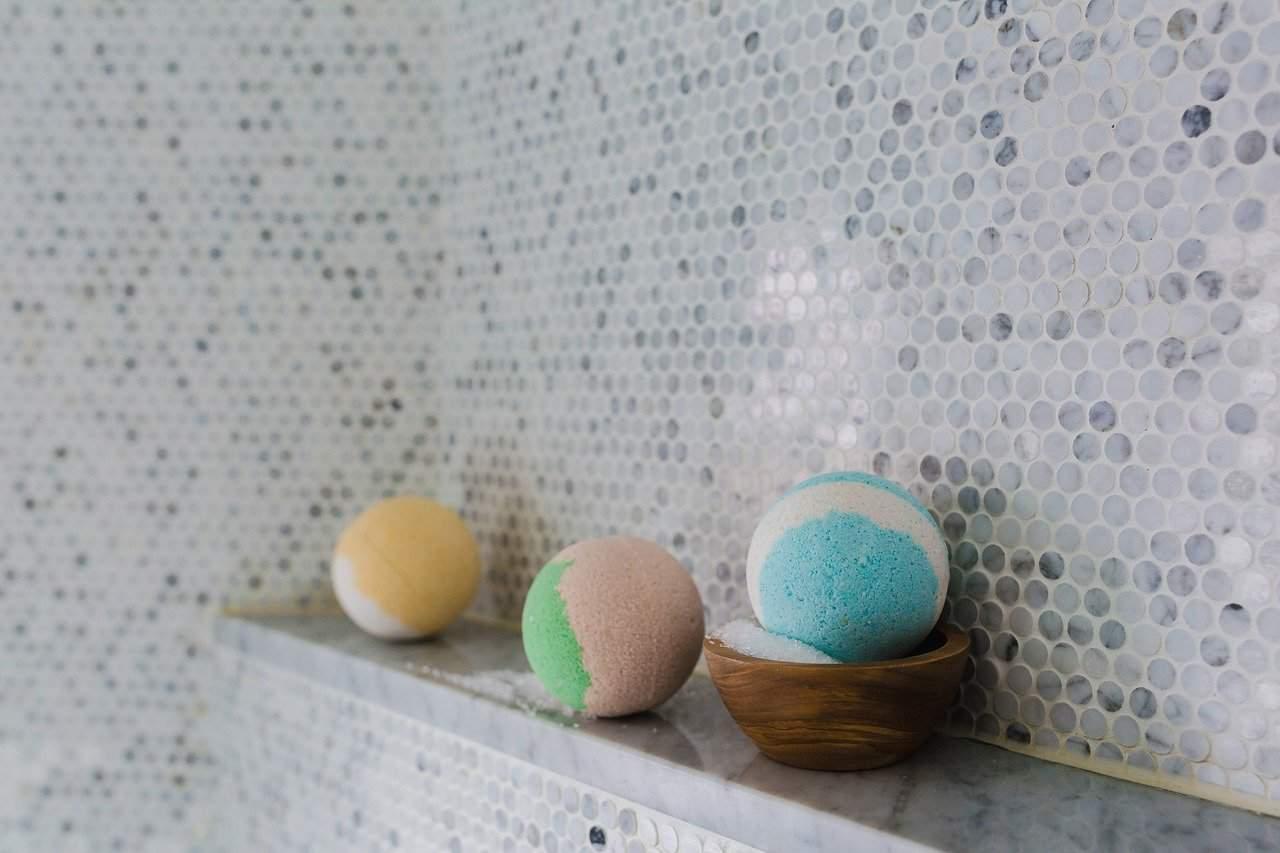 cbd bath bombs on a bath shelf