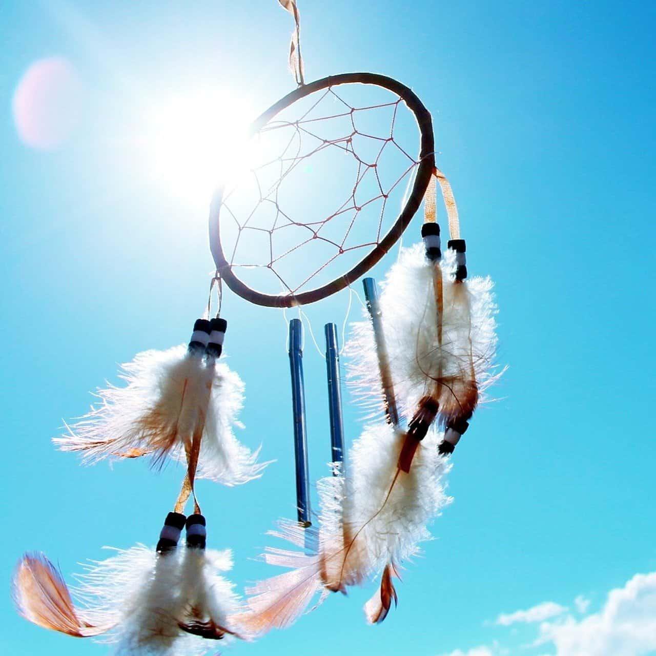dreamcatcher on a blue sky background